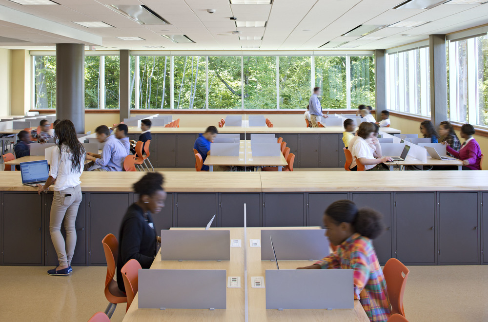 Learning Studios outside the classroom replicate the real-world settings students may encounter in work or college and provide each with a desk and project storage space.